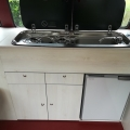 White wood grain split screen camper interior